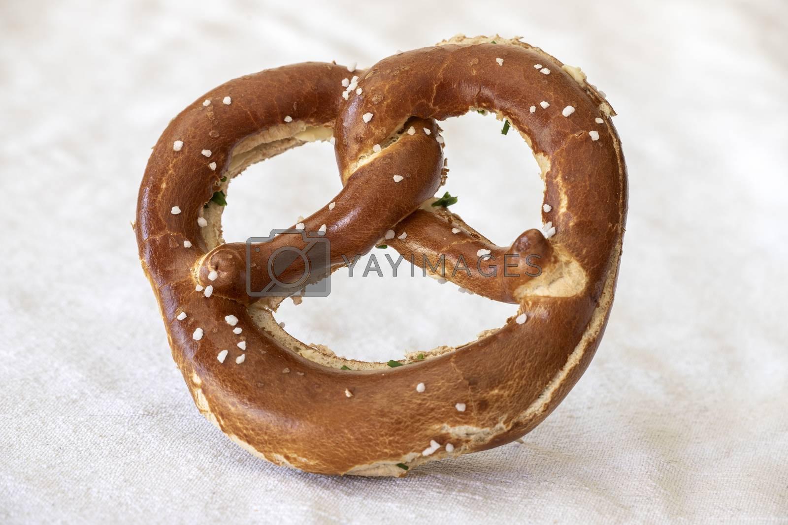 bavarian pretzel with butter on white