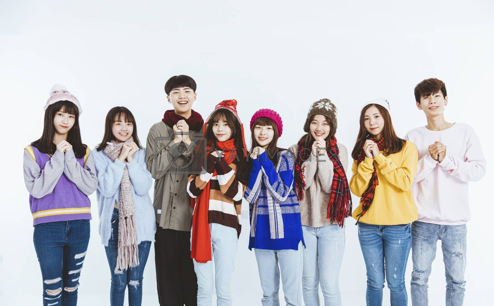 happy asian young people in winter clothes with Congratulations gesture for chinese new year