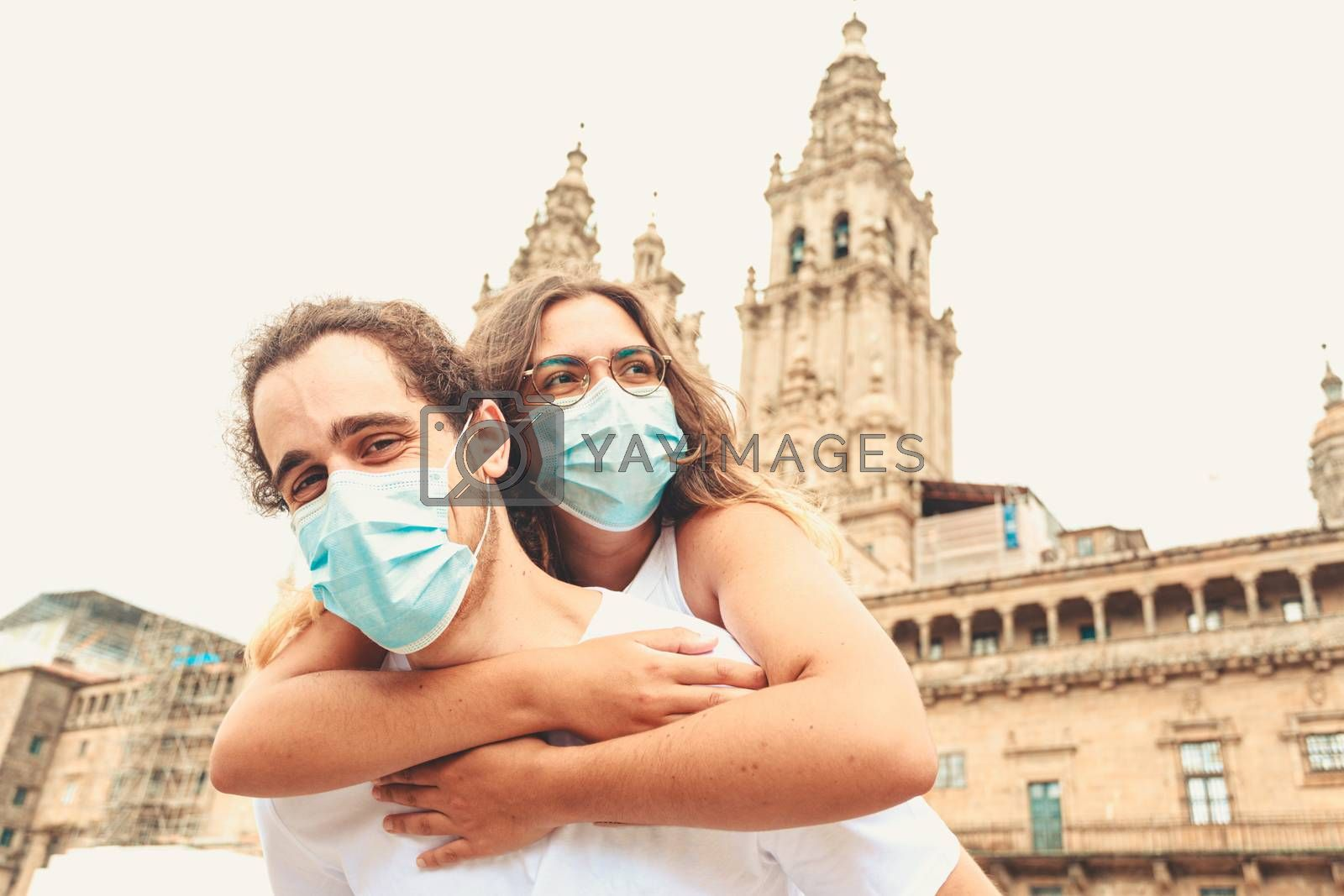 A young couple having a good time while traveling having the masks put on