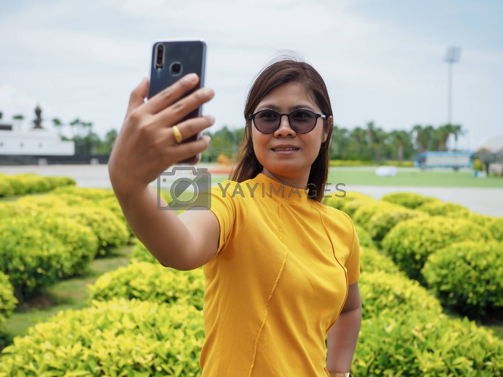 Woman taking a selfie while traveling