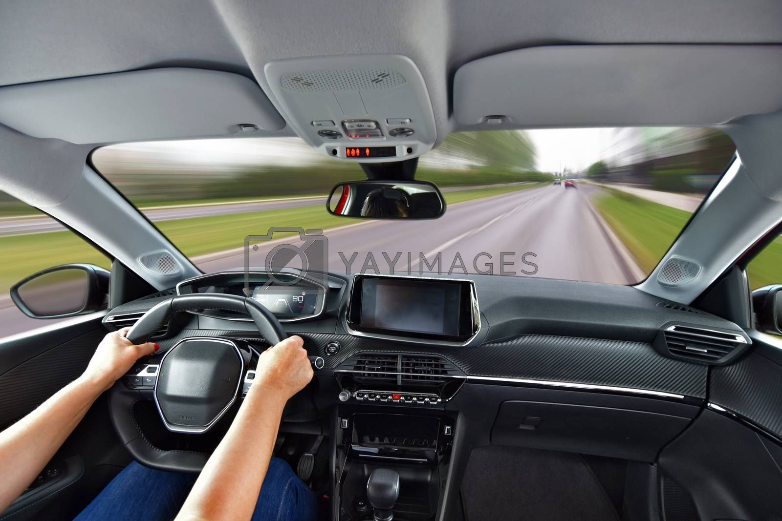 Royalty free image of Driving a car. Woman driving a car fast. by aselsa