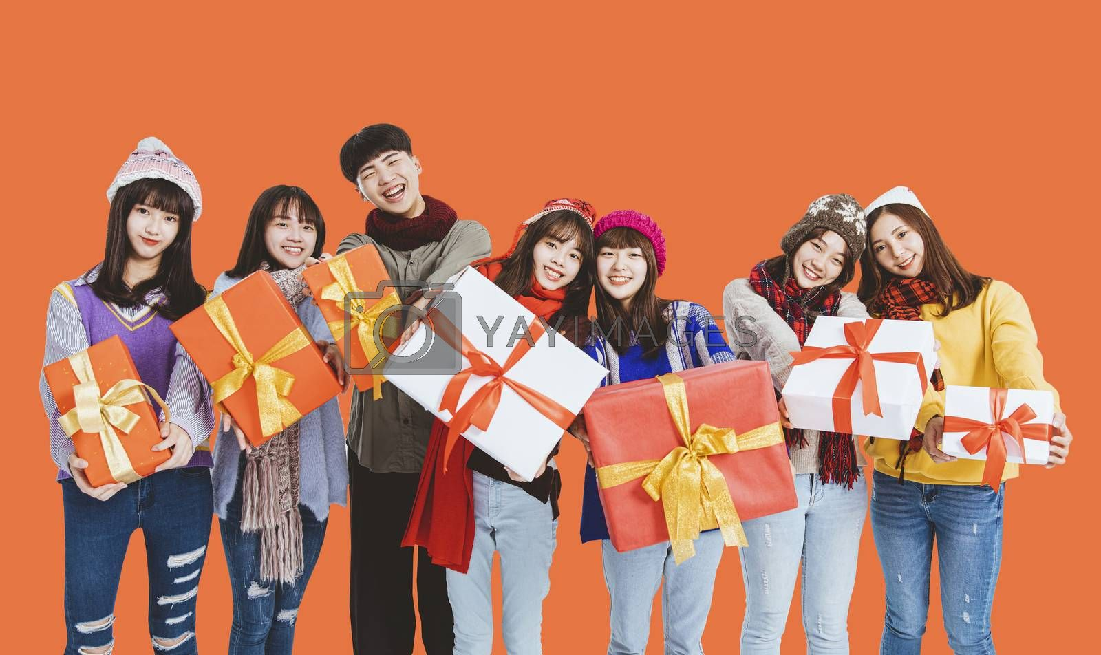 happy young  group  showing the  gifts and celebrating Christmas festiva and new year holiday