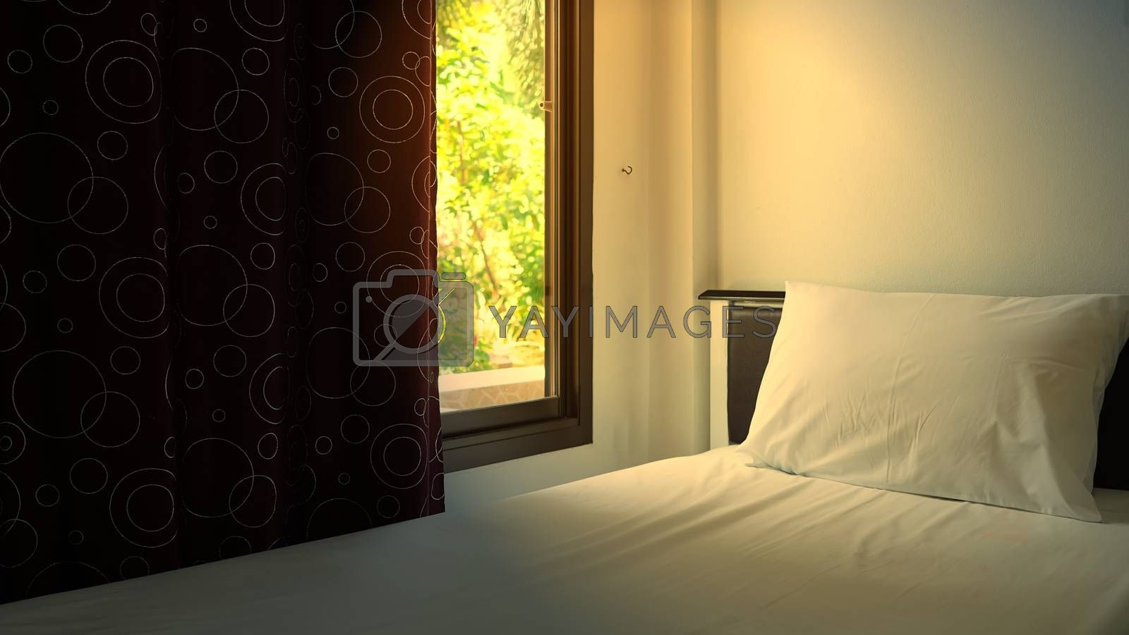 The bedroom with curtains opened to show the morning sun, the concept of refreshing for a new day.