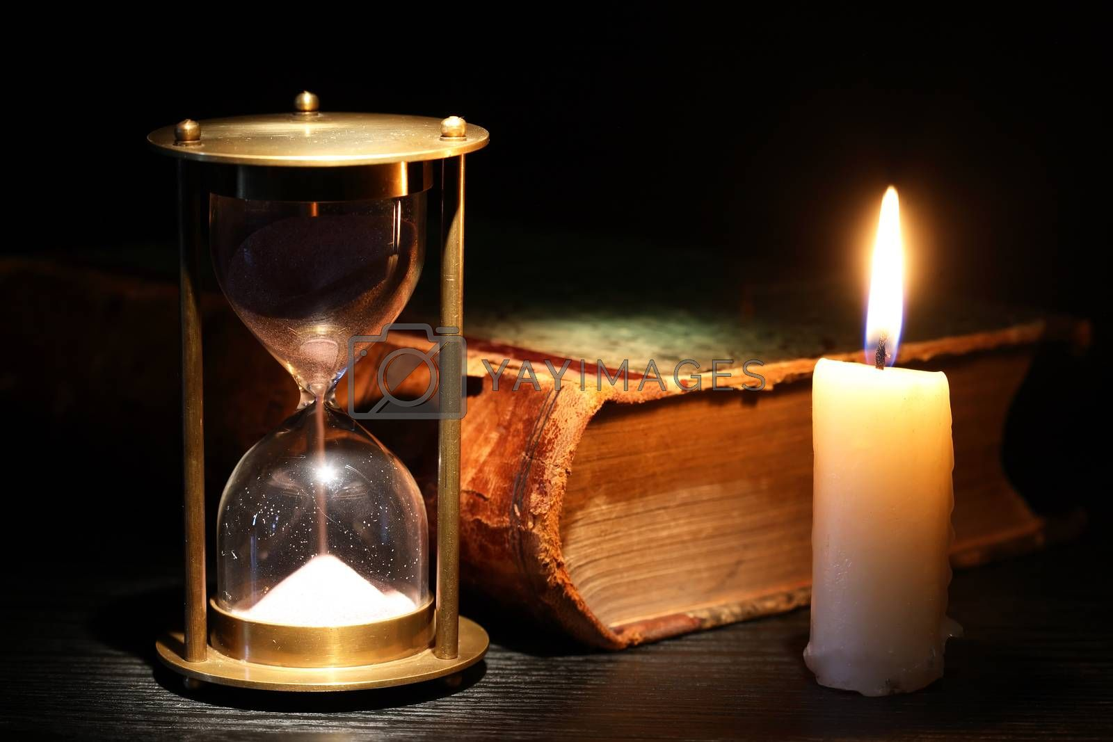Royalty free image of Hourglass And Candle by kvkirillov