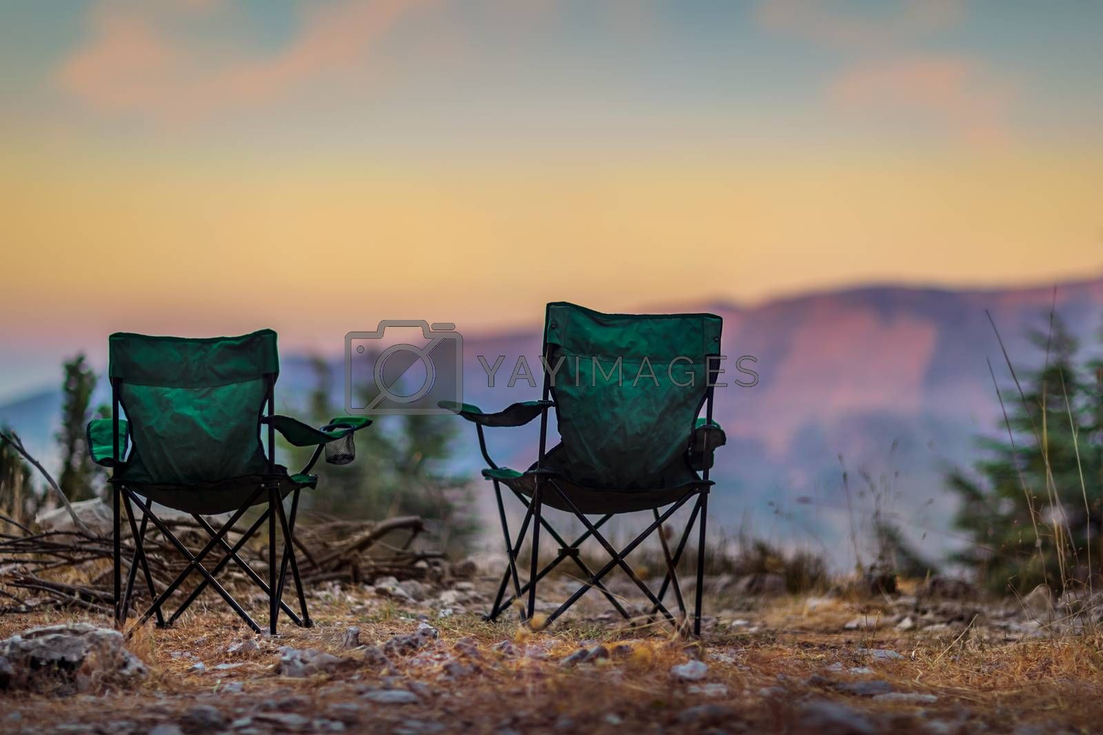 Two Empty Camping Chairs Standing on the Top of the Mount. Perfect Place for Watching Sunset. Actice Relaxation Lifestyle