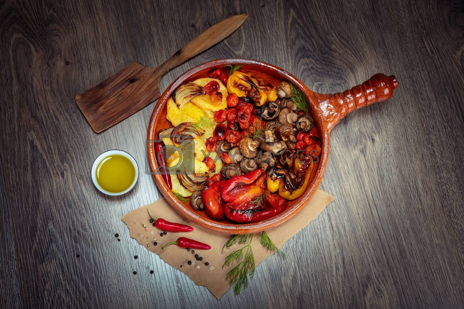 Food Flat Lay Still life on Wooden Table. Frying Pan with Delicious Grilled Vegetables. Seasonal Oven Baked Vegetables. Healthy Organic Vegetarian Dish. Diet and Weight Loss Concept.