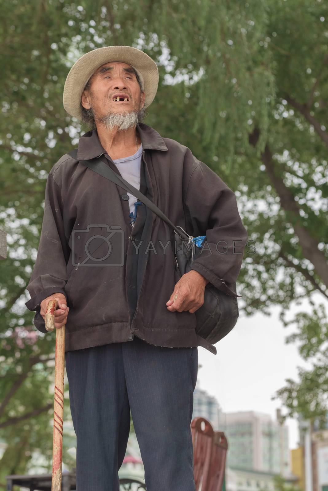 Harbin, Heilongjiang, China - September 2018: Asian old man with a cane