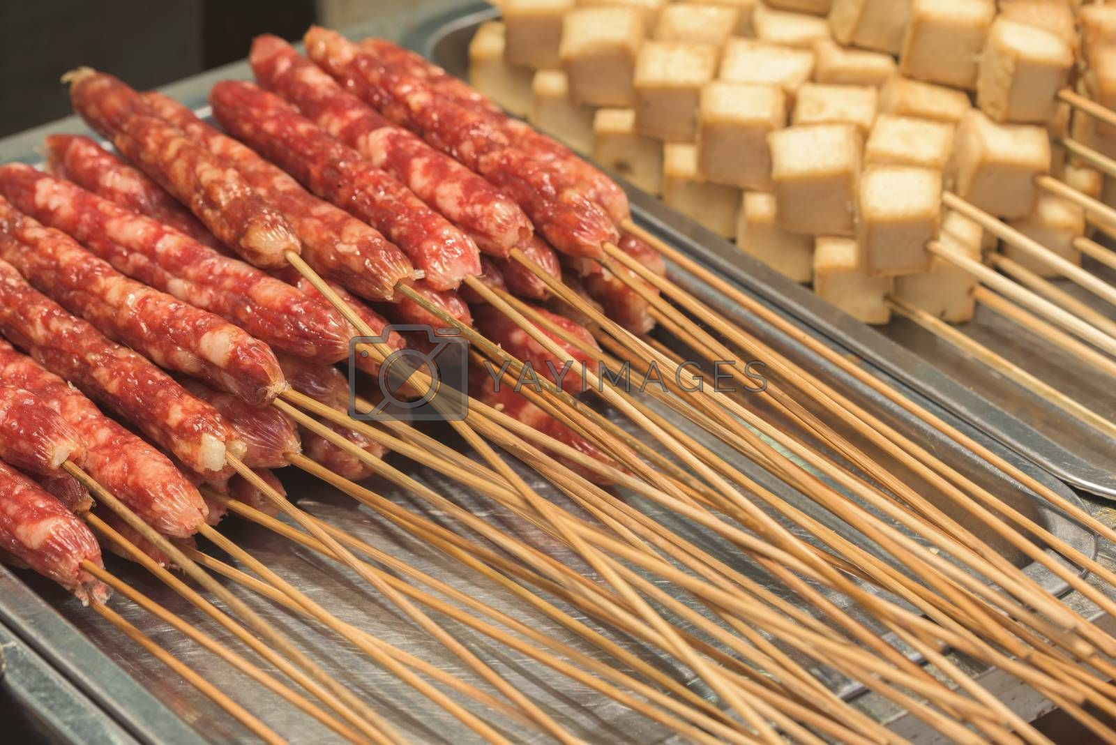 Street food asia. Meat on a stick. Chinese street food
