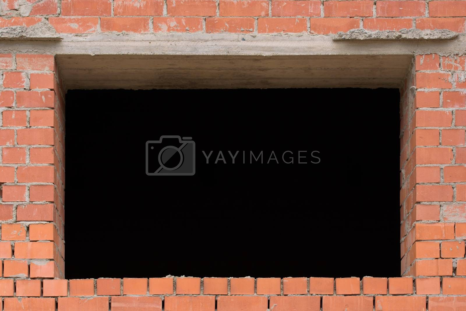 Brick wall. Old brick wall with window aperture