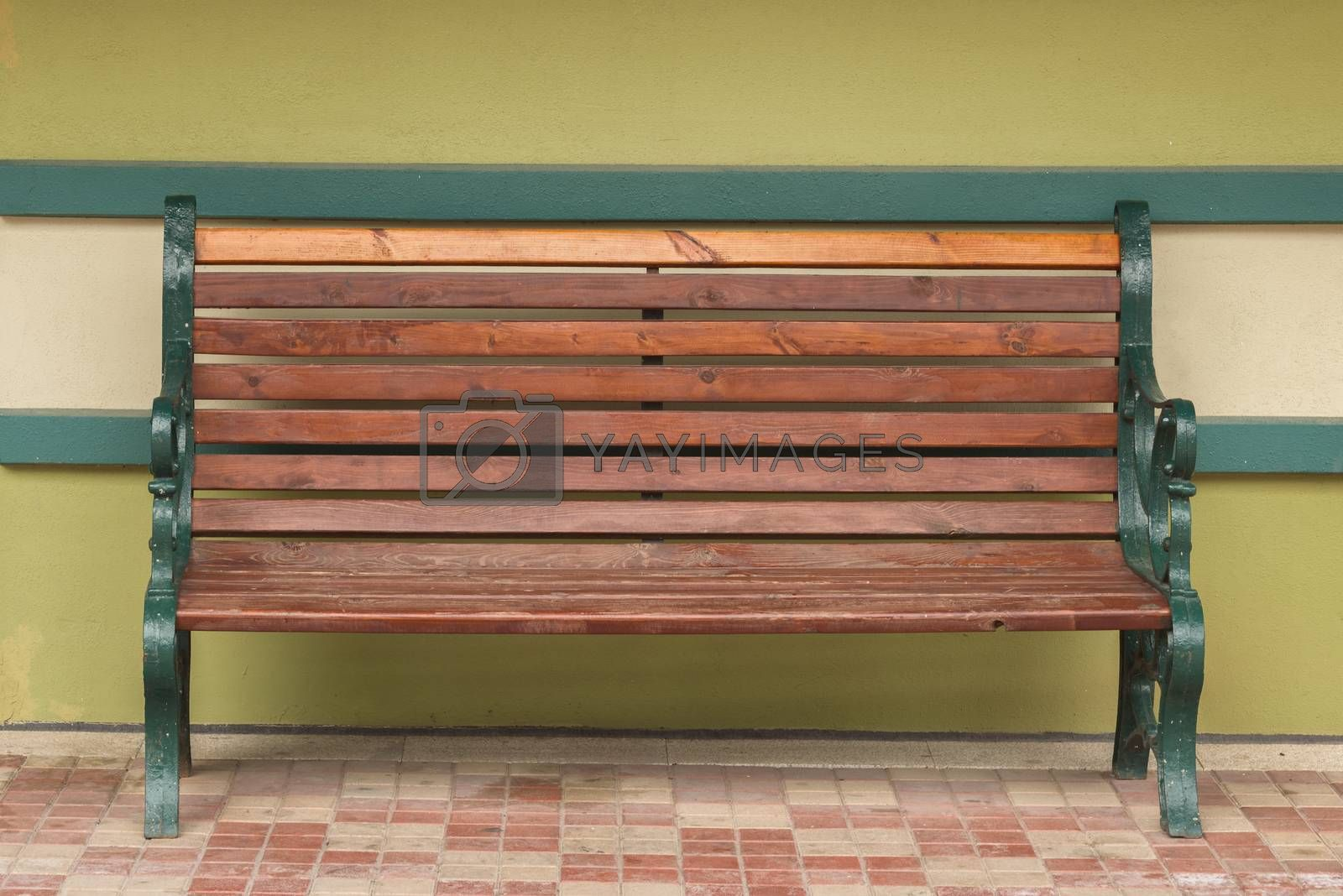 Bench against the wall. Old wooden bench