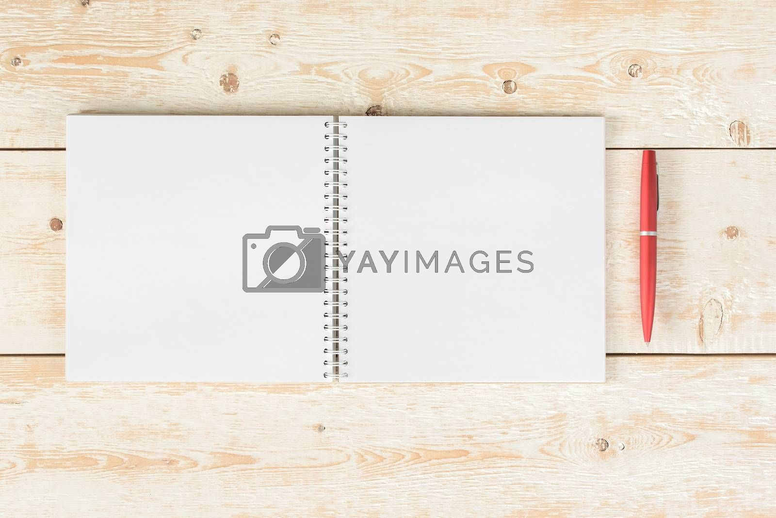 Blank notepad on desk. Blank notebook with pencil on wooden table