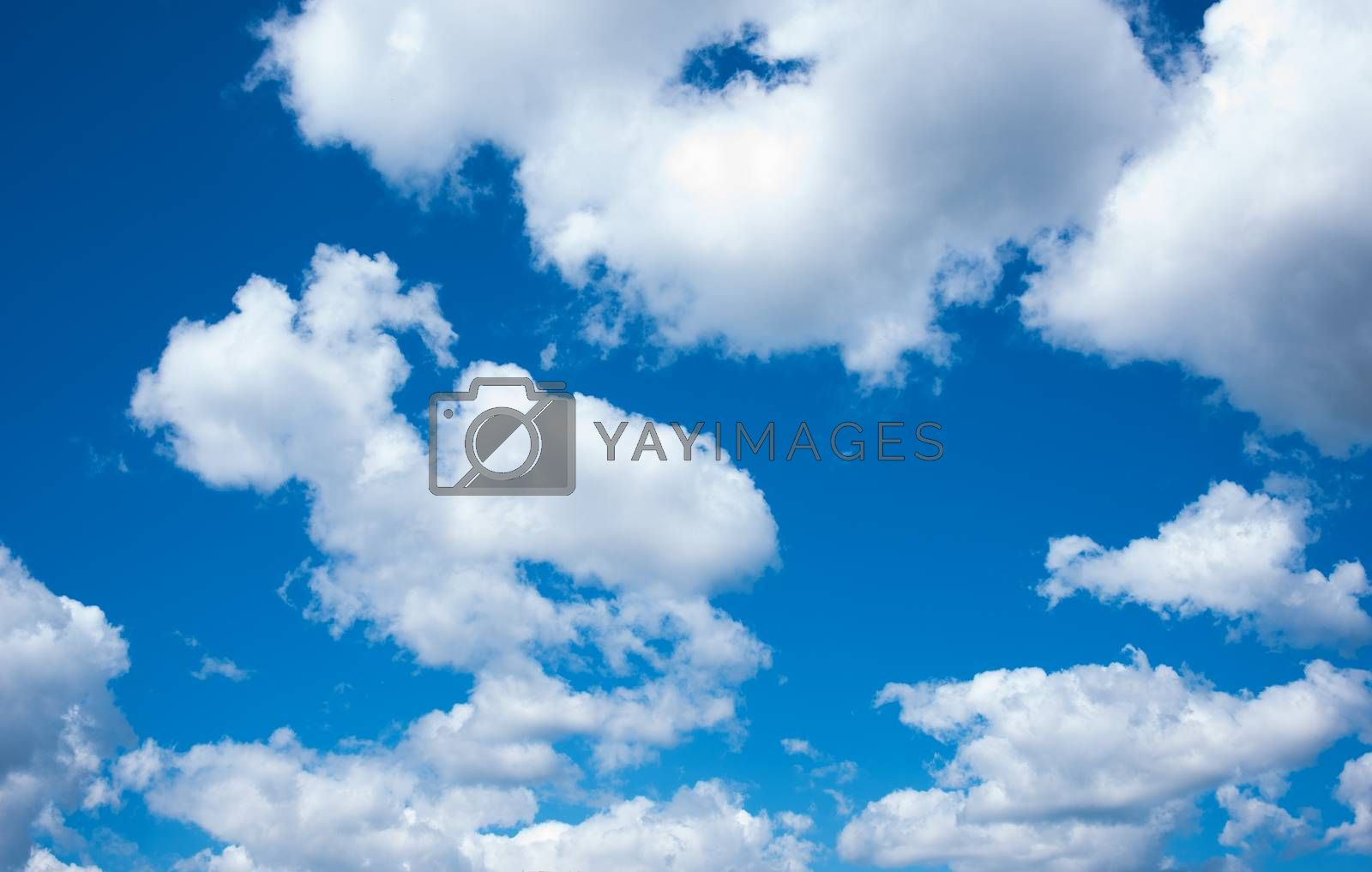 Blue sky with white clouds. Background with clouds