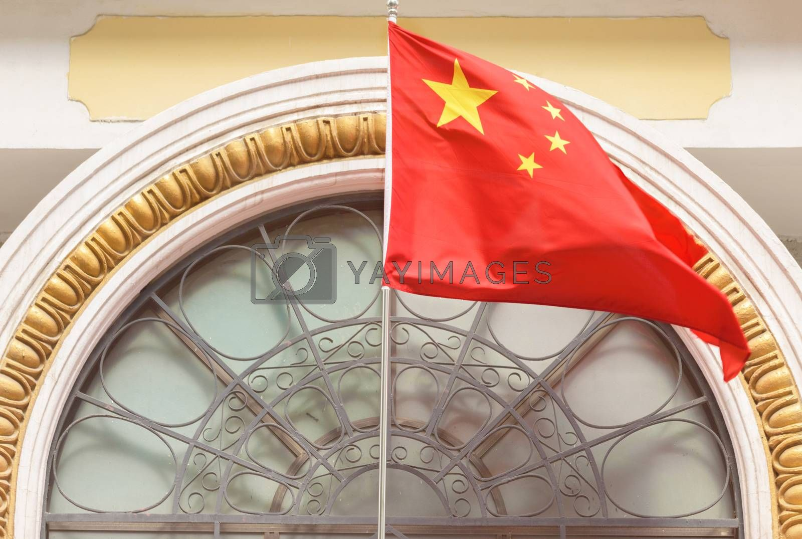 Chinese flag. Chinese flag on the facade of the building