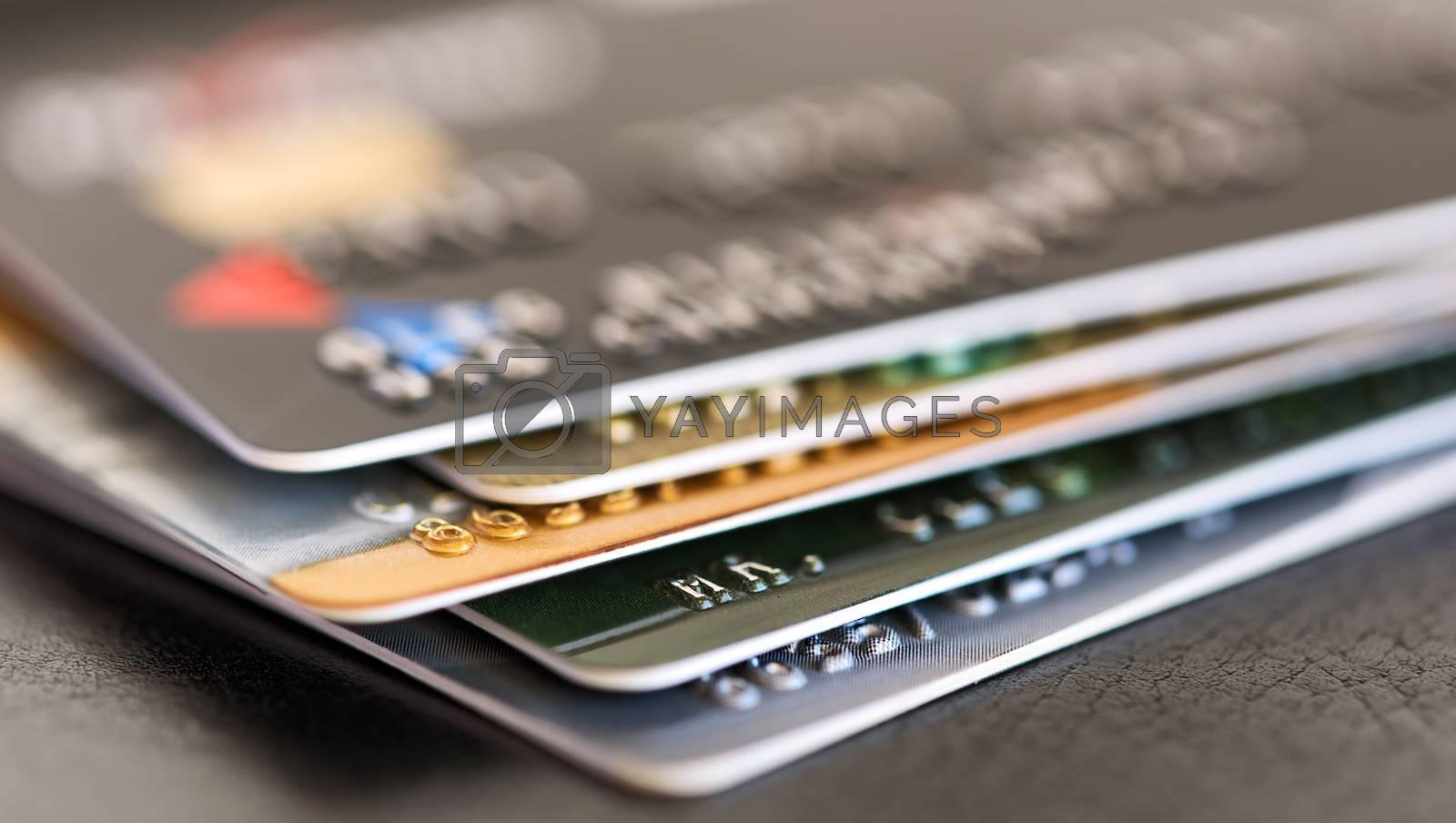 Credit card close-up. Credit card pile. Plastic card on black background