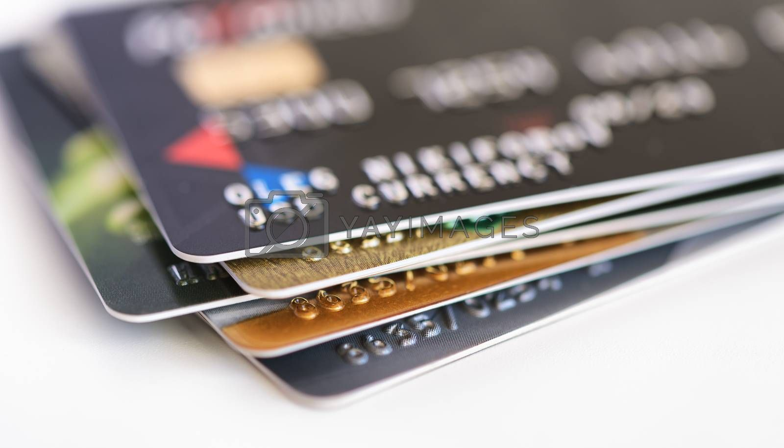 Credit card close-up. Credit card pile. Plastic card on white background