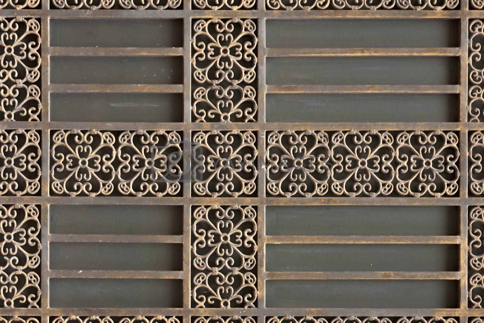 Decorative metal grille. Structure and ornaments of wrought iron