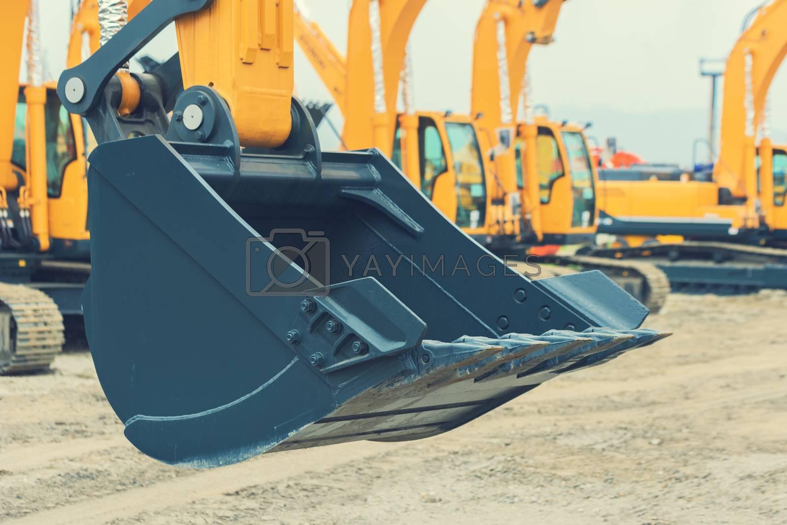 Excavator bucket close-up. Heavy scoop of a new excavator