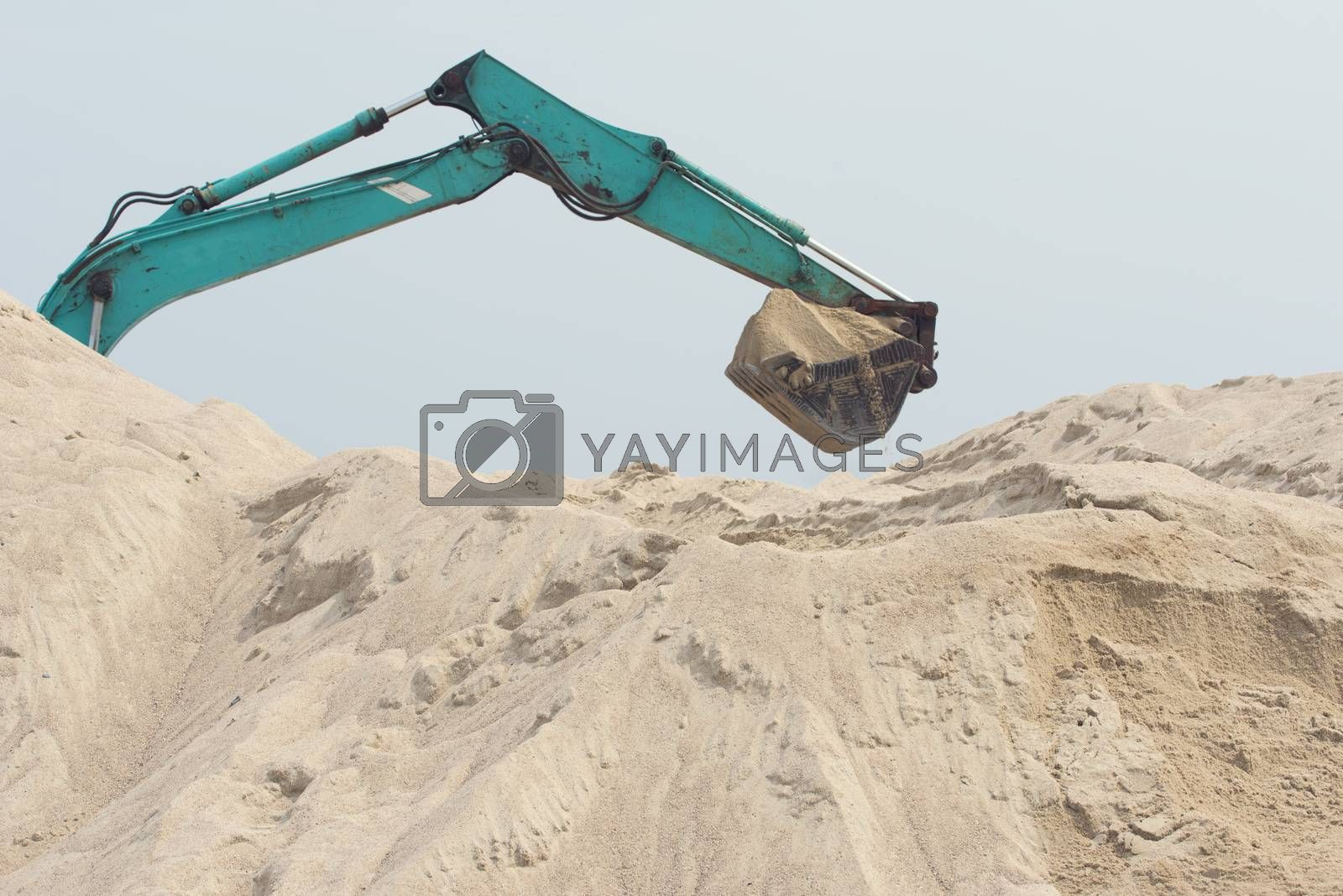 Excavator is digging sand. Construction excavator on the construction site in a quarry