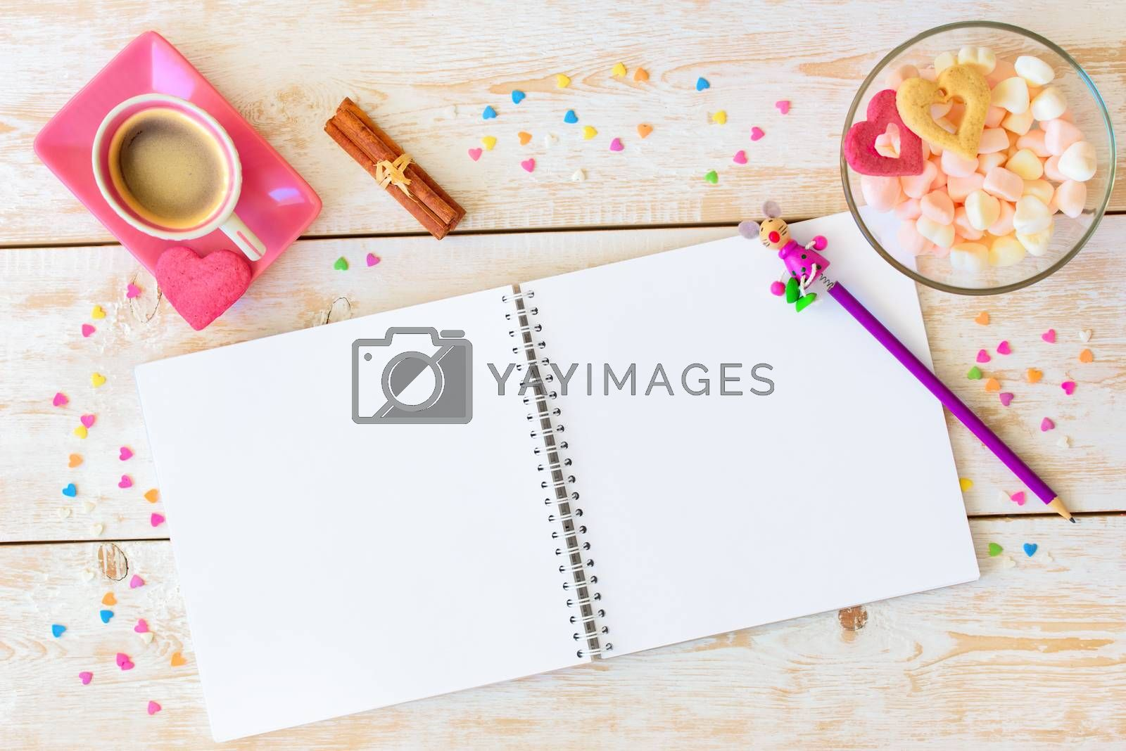 Blank paper on table. Blank sheet of paper, coffee cup, cookie, pencil on wood background. Design mockup