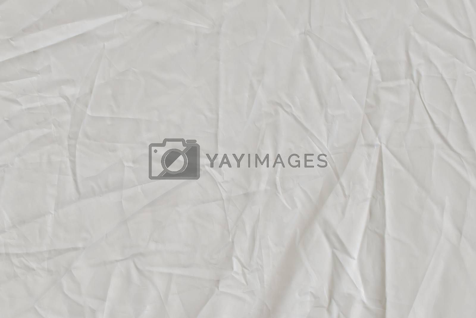 White textile background. Fabric of white color.
