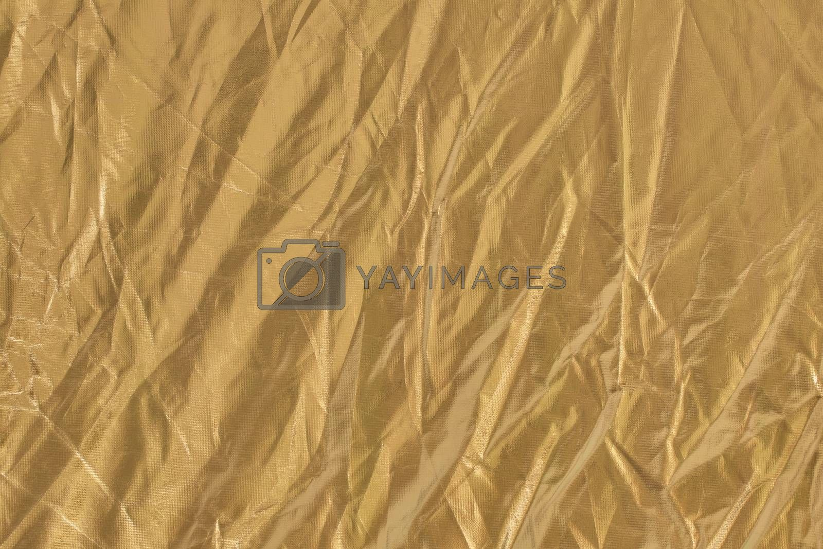 Golden textile background. Fabric of yellow color.