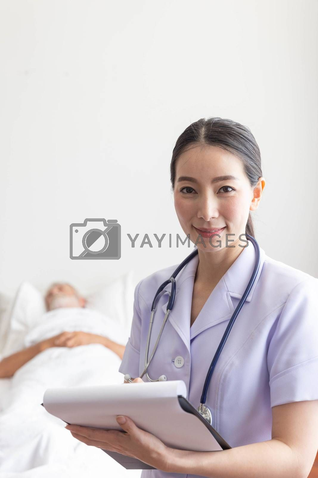 Young female nurse smile with medical record in front of a sleeping old man patient