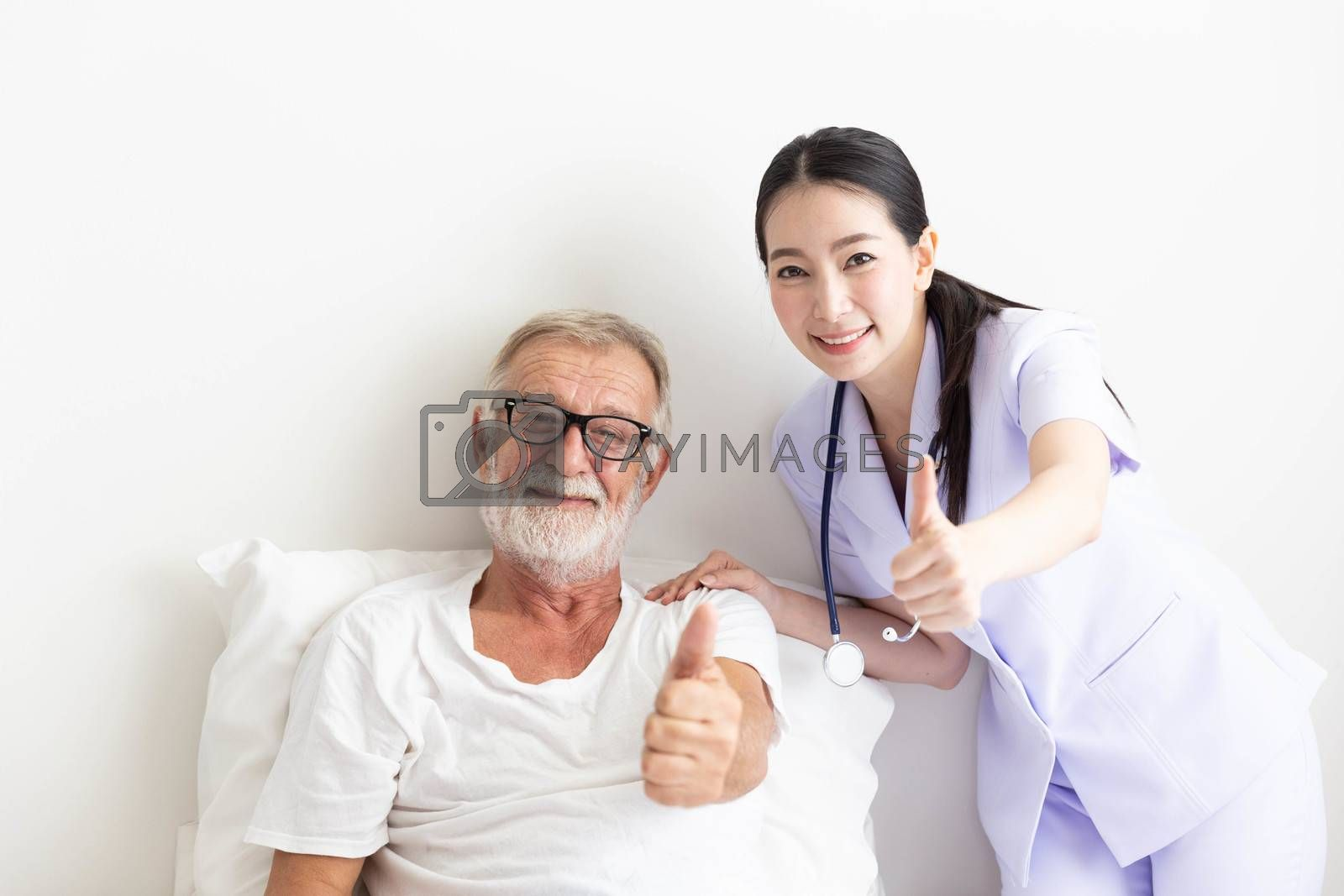 Senior retirement man and asian nurse show thumb up with smile  in a room
