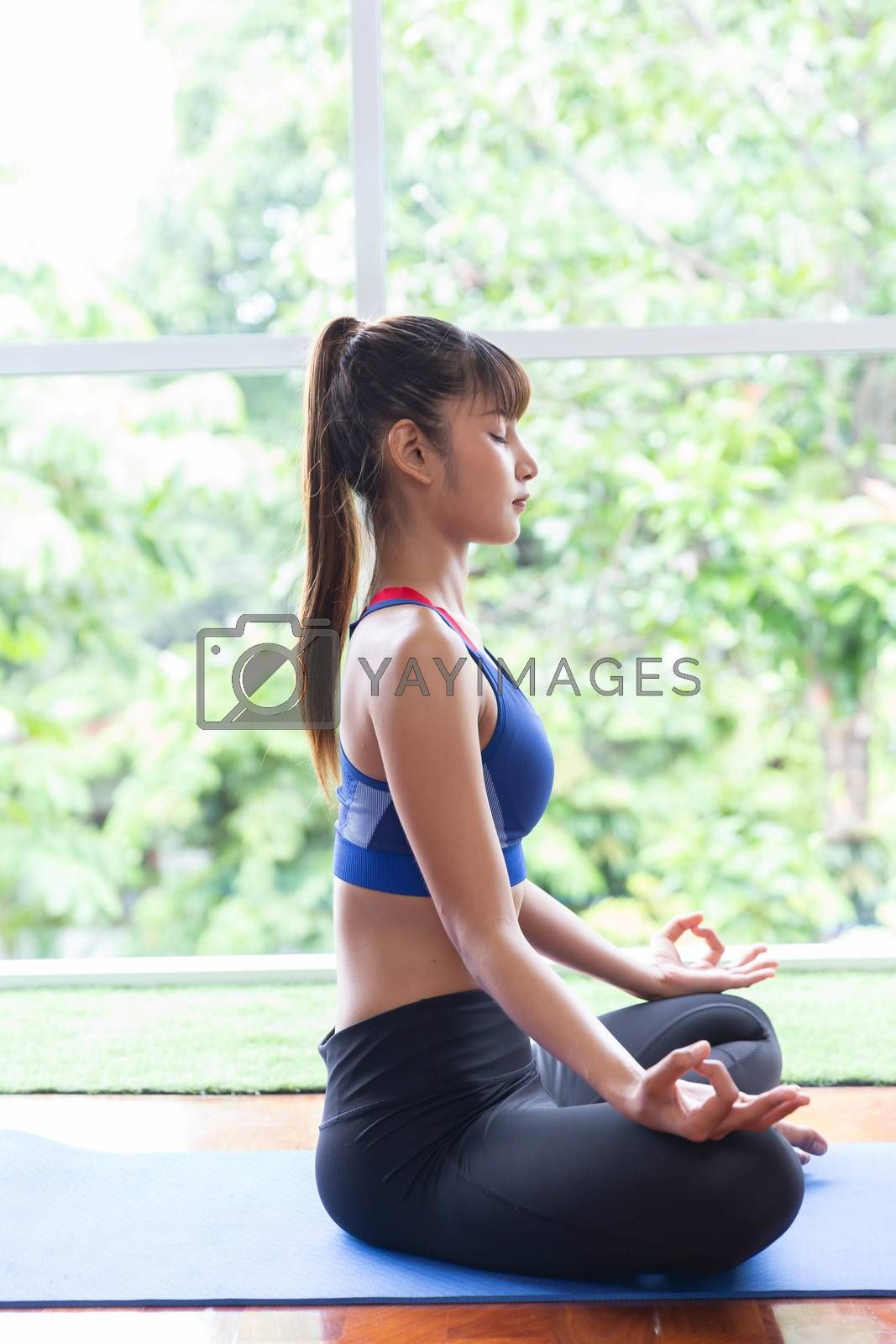 A sport girl relax exercise yoga at home