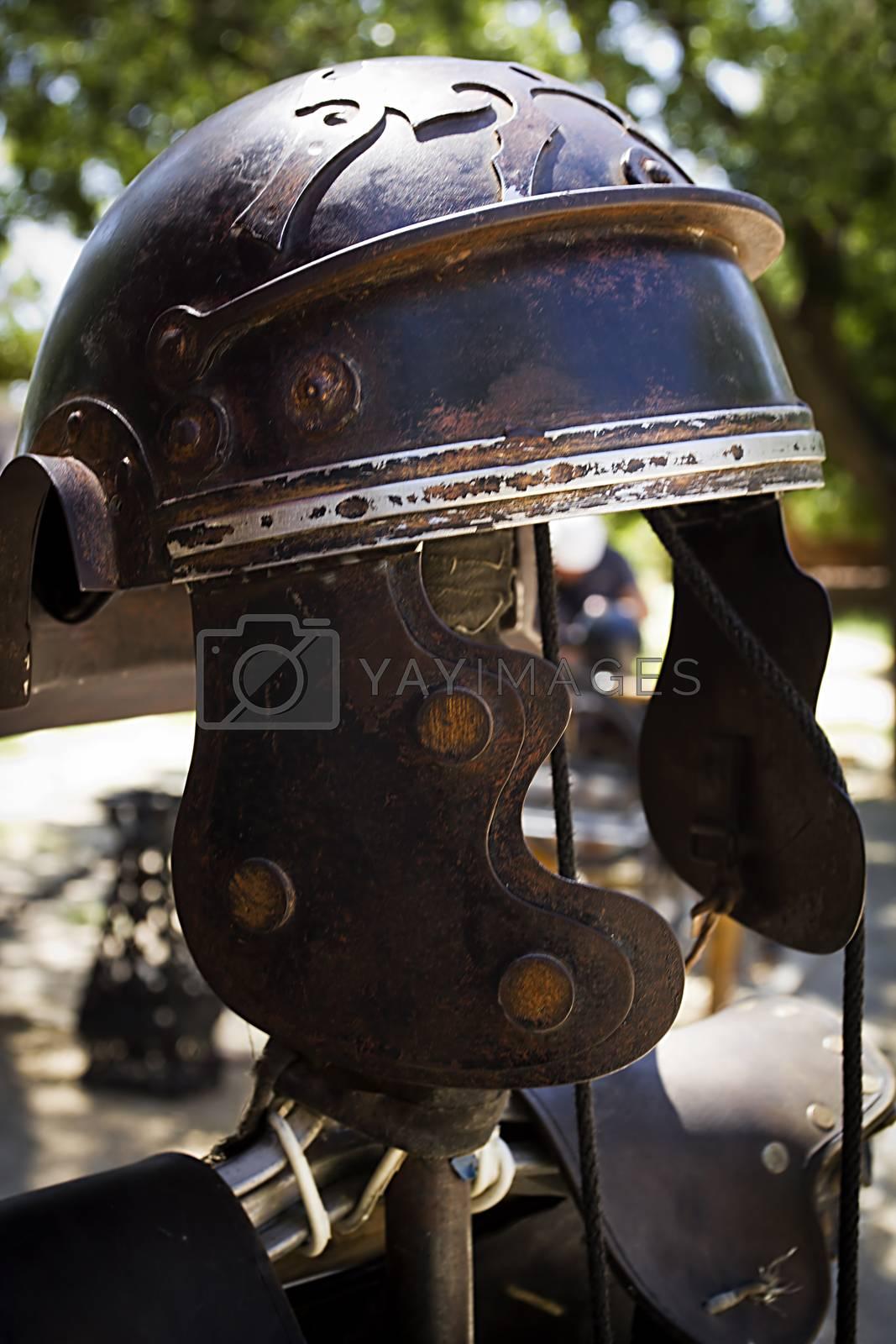 Vintage helmet of a roman warrior outdoors
