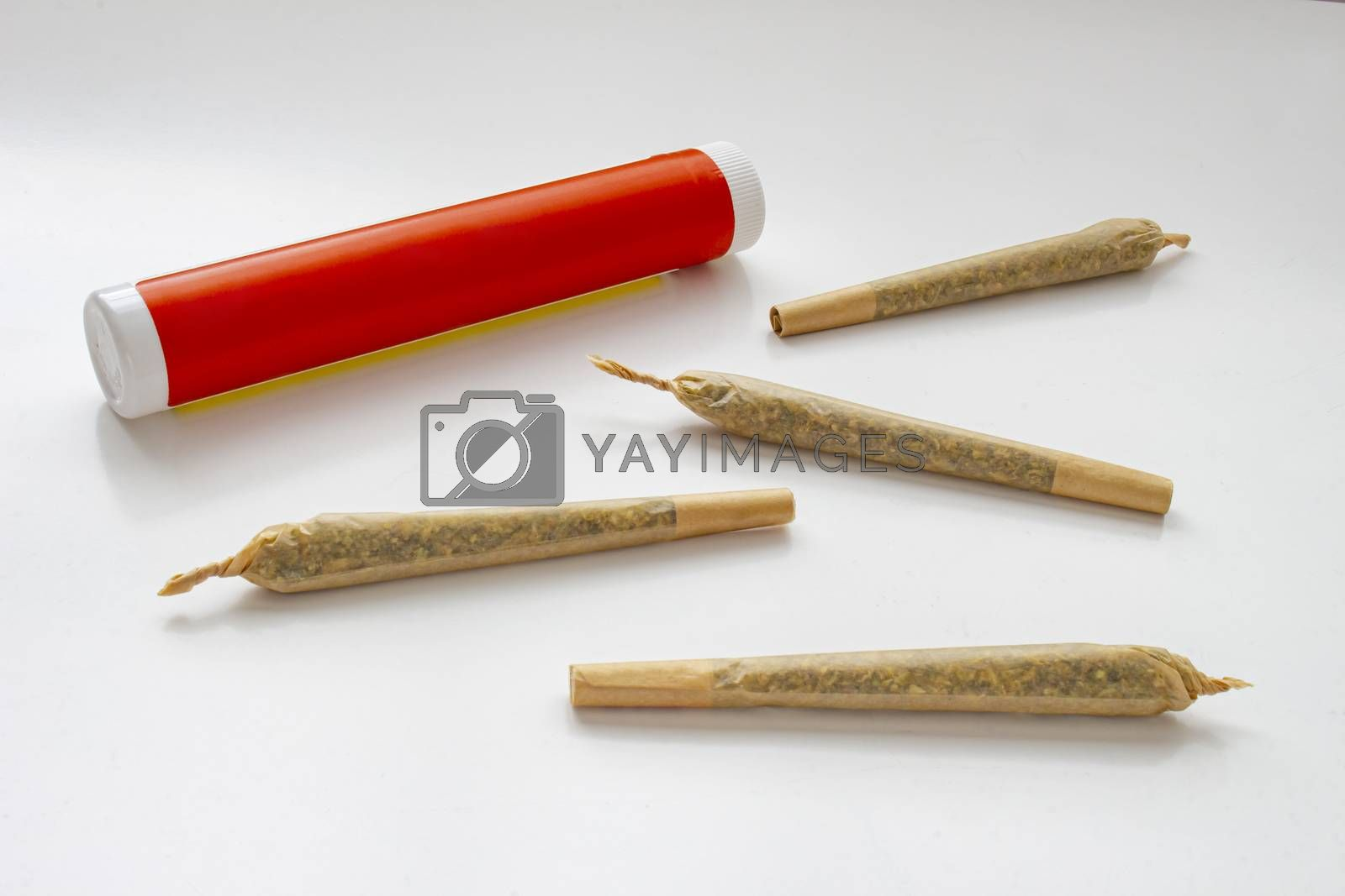 A Cannabis white and red plastic packaging container for Prerolls or Joints with pre-rolls cannabis joints around and a on a white background