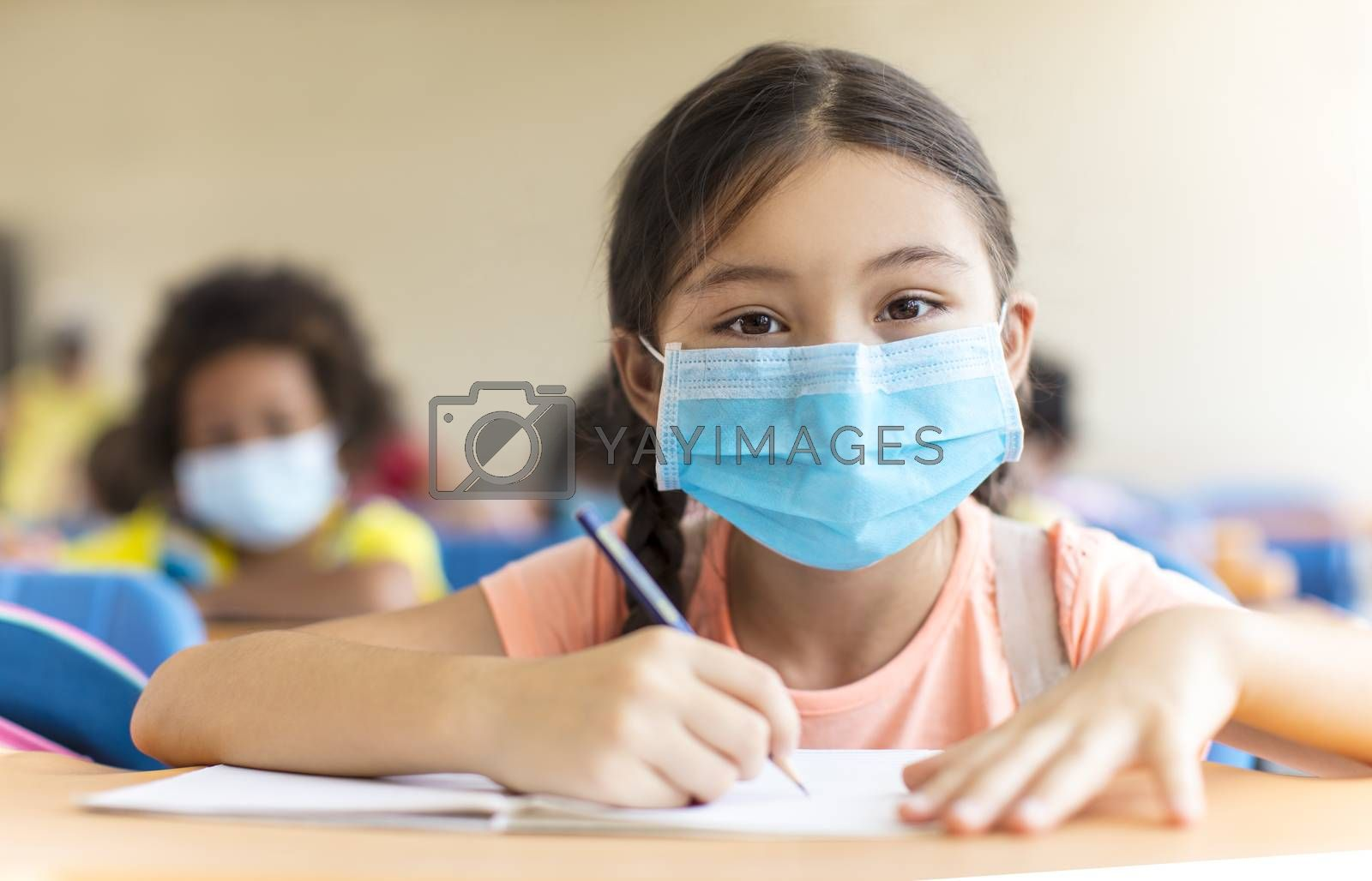 students wearing  mask and  studying in the classroom.