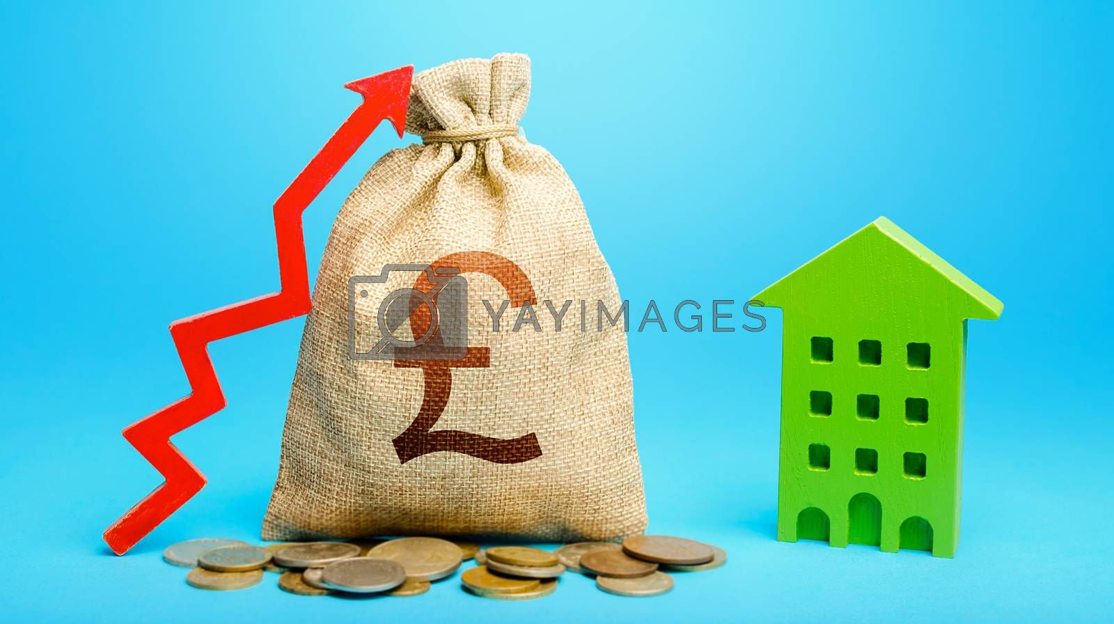British pound sterling money bag with red up arrow and residential building. Recovery and growth in property cost. Return on investment. Increase in prices for apartments and housing. Municipal budget