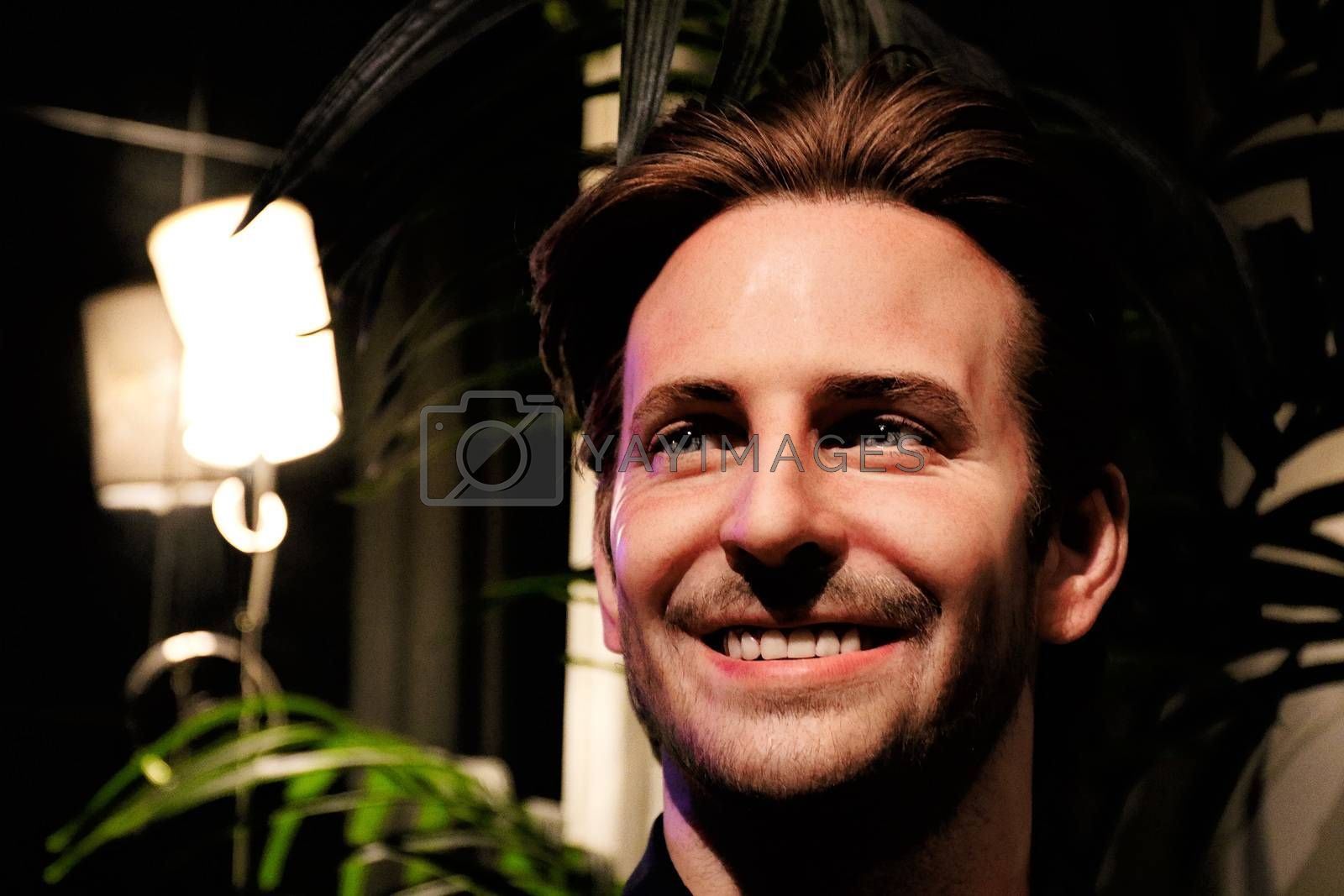 Royalty free image of Bradley Charles Cooper wax figure with movie set from HANGOVER movie by USA-TARO