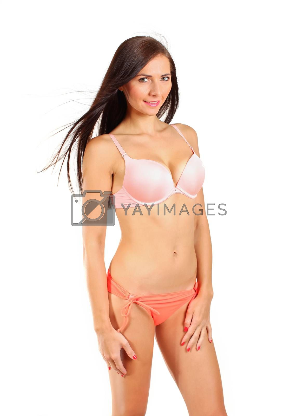 Royalty free image of Young brunette woman in bikini underwear isolated on white backg by Ivanko