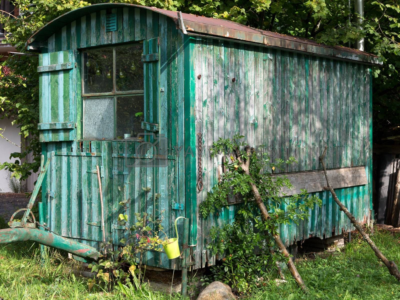 Royalty free image of Old weathered wooden contractor's shed in the garden by Kasparart