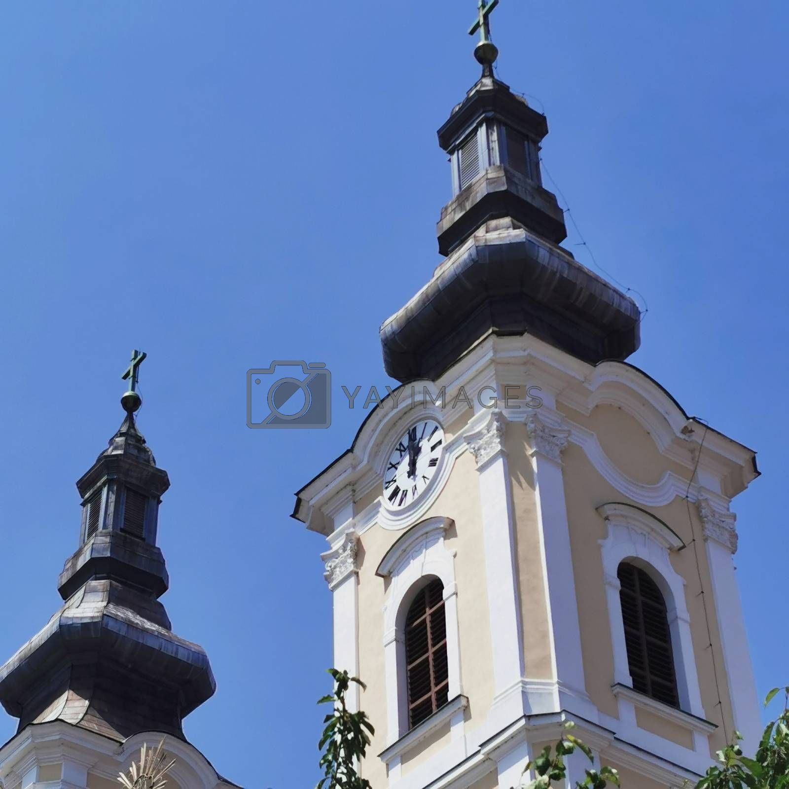 Royalty free image of The church in Miskolc is close up with the beautiful large number plate clock by balage941