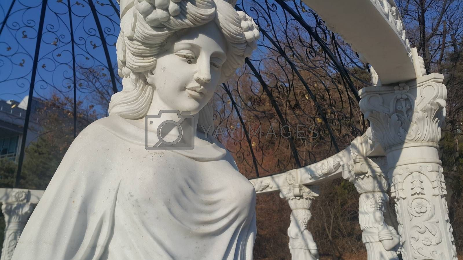 Royalty free image of Statue of Greek Goddess Head with lovely hair settled in a public park by Photochowk