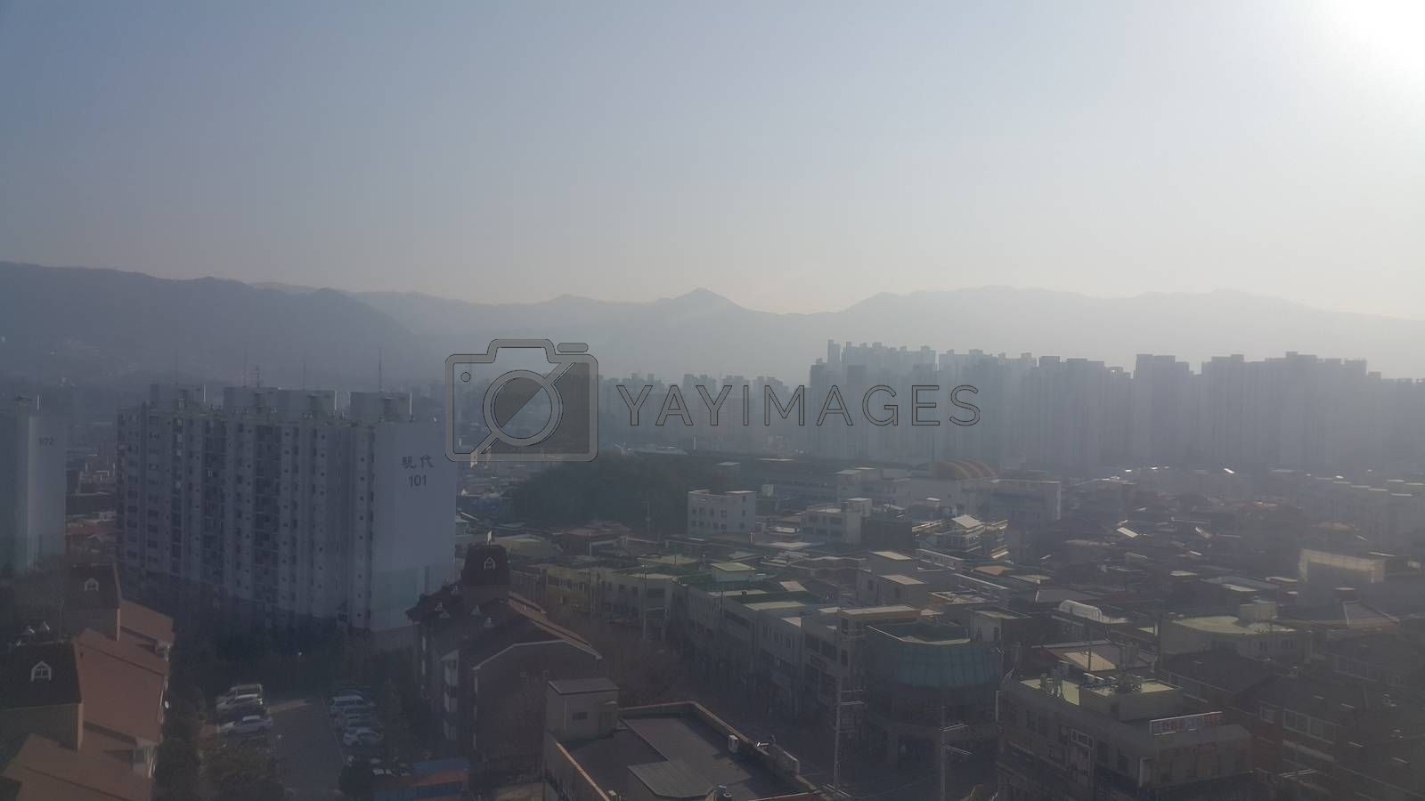 Royalty free image of Cityscape aerila view of developed country  by Photochowk