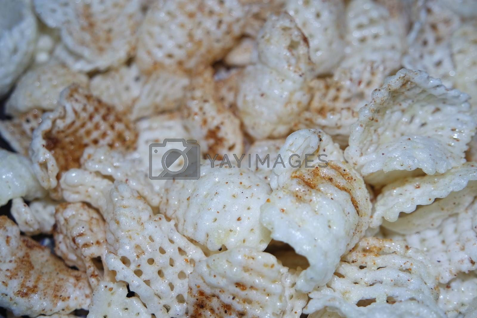 Royalty free image of Closeup view of freshly fried chips as fast food usually eaten with tea. by Photochowk