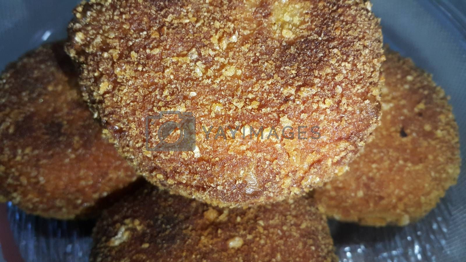 Royalty free image of Closeup view of fried pizza bombs or pizza balls are altered form of pizza. by Photochowk