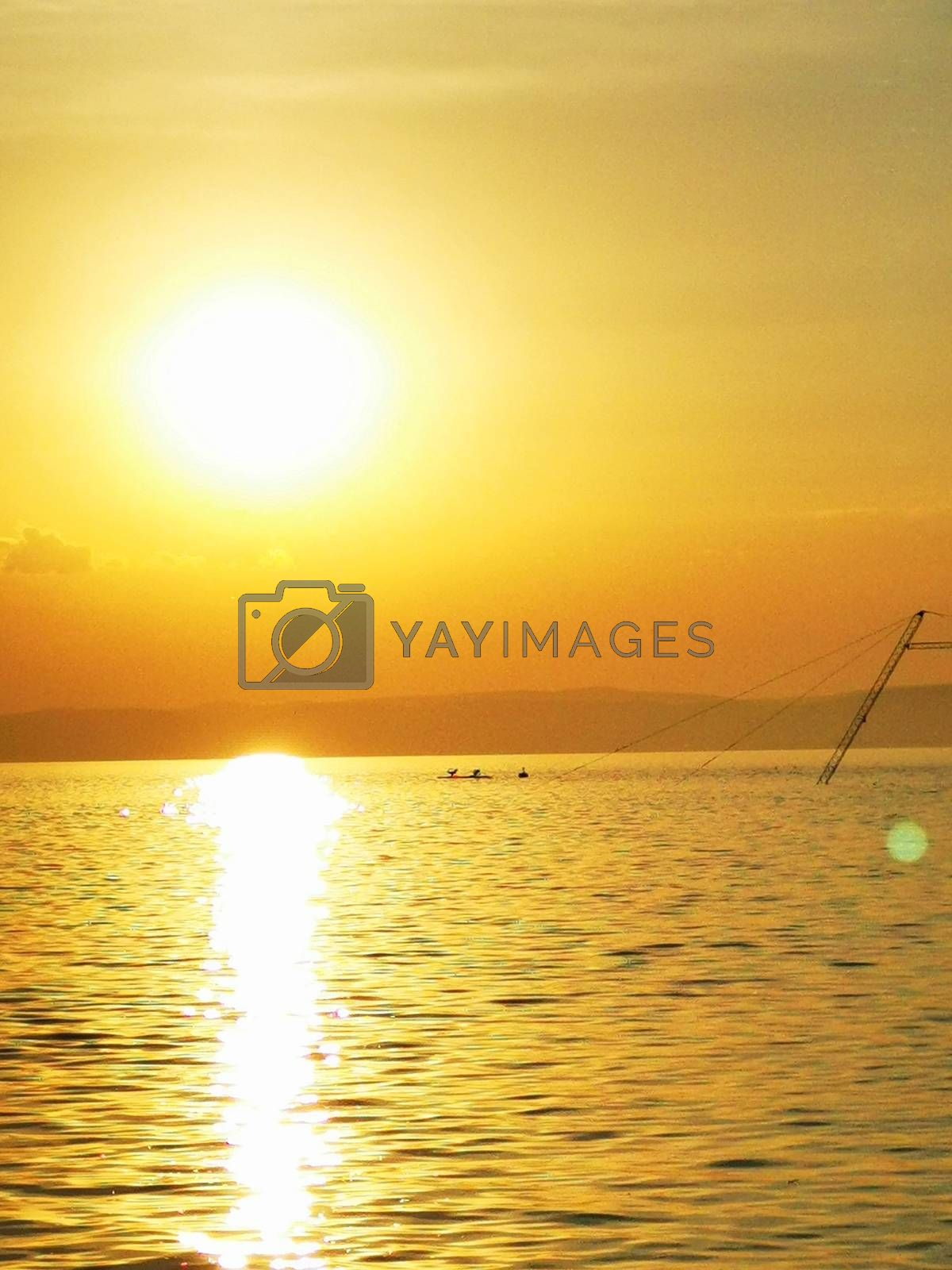 Royalty free image of A sunset over a body of water by balage941