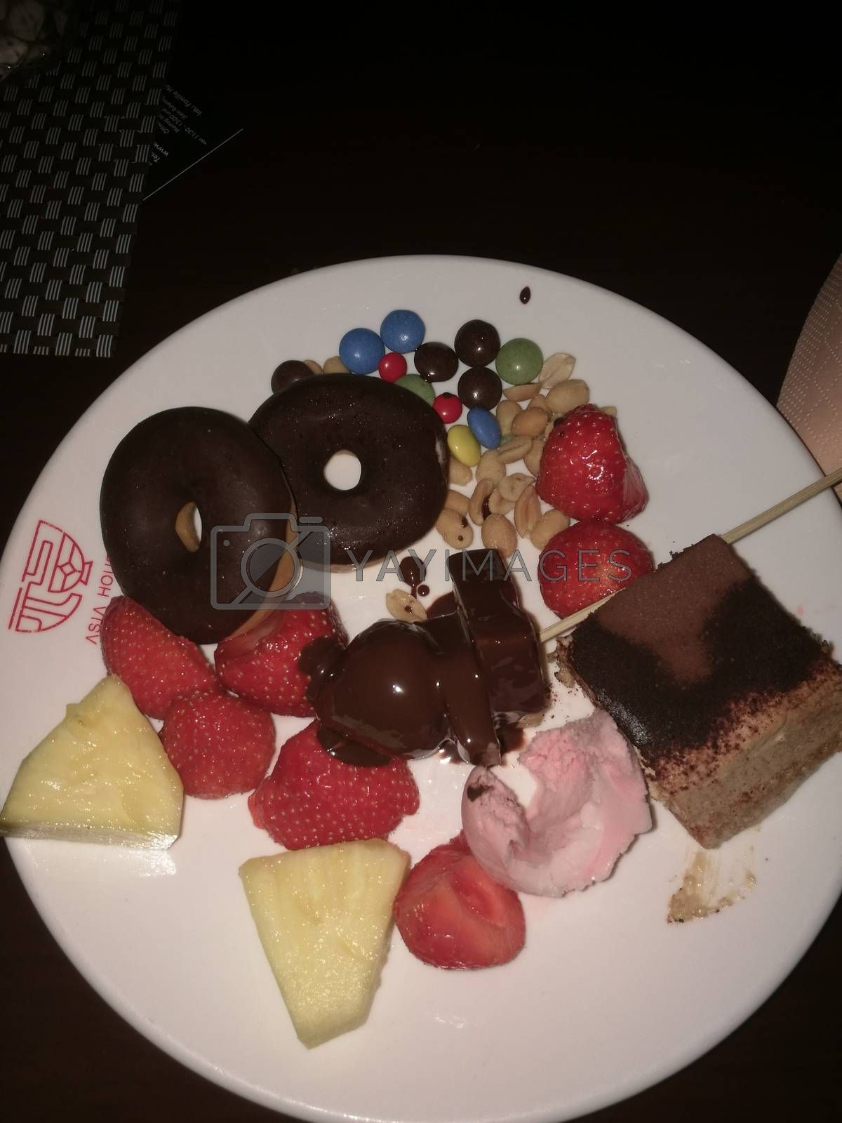 Royalty free image of A piece of chocolate cake and fruits on a plate by balage941