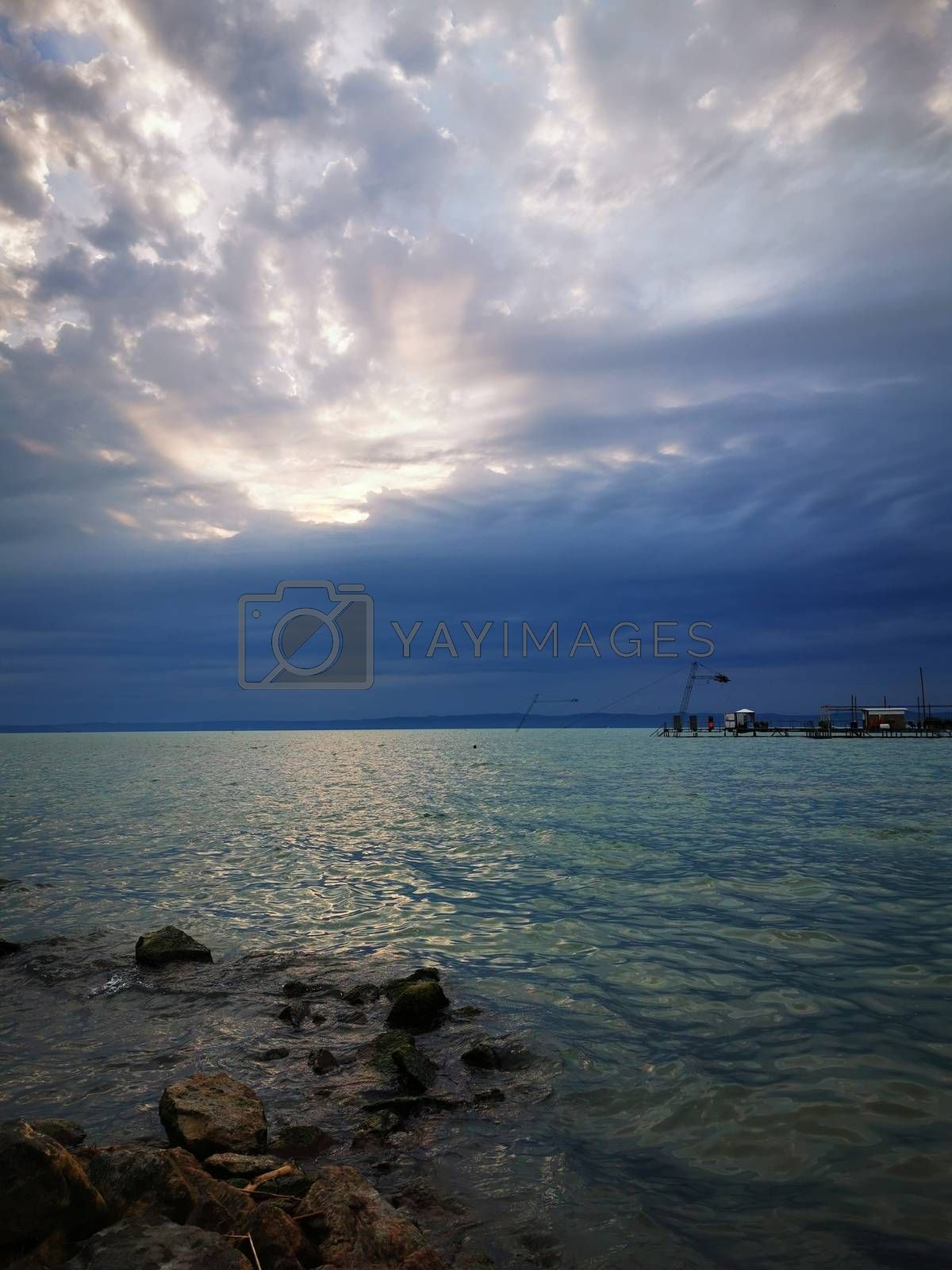 Royalty free image of Clouds in the sky over a body of water by balage941
