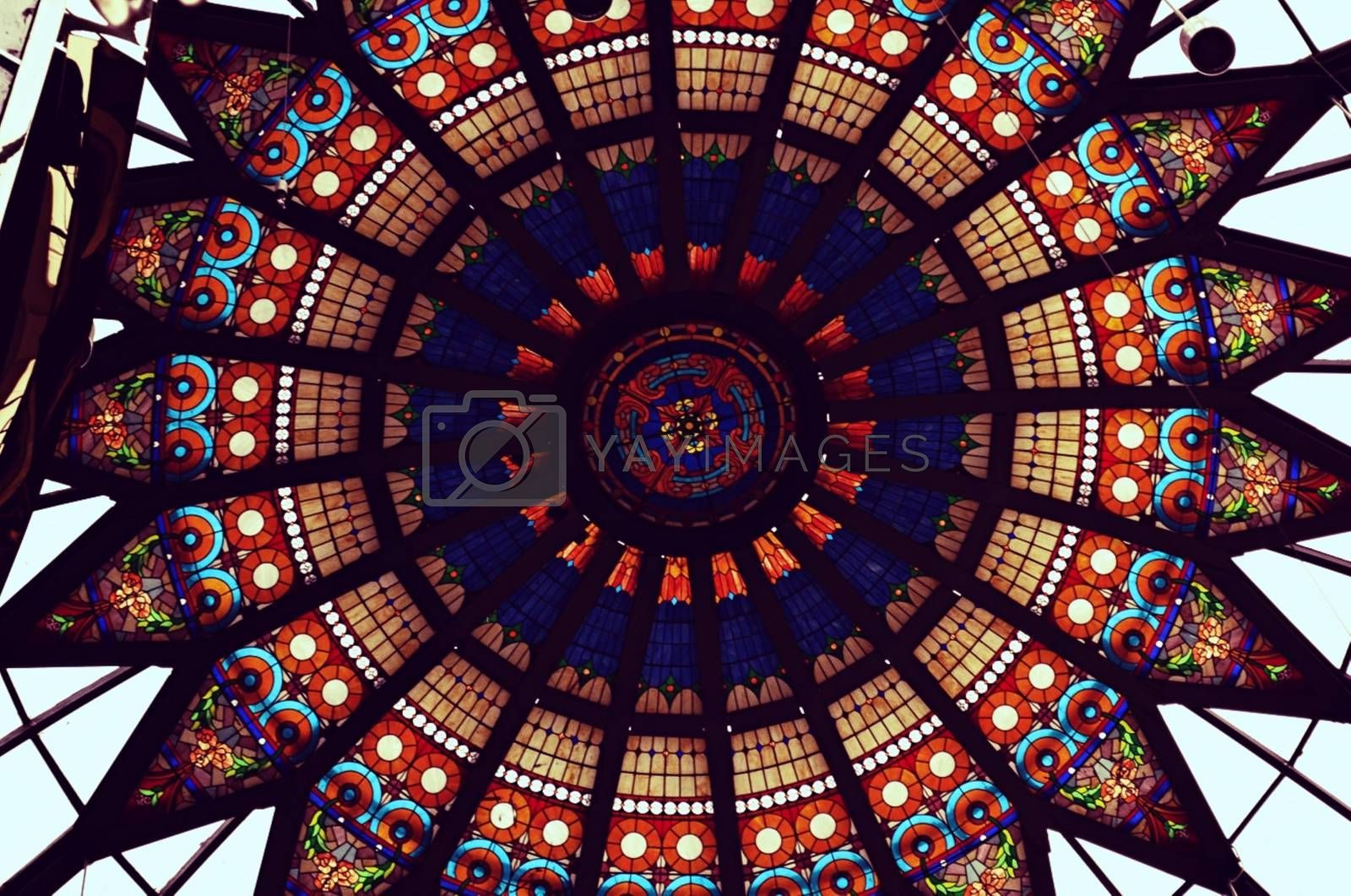 Royalty free image of Colorful, ornate window in the form of a circle by balage941