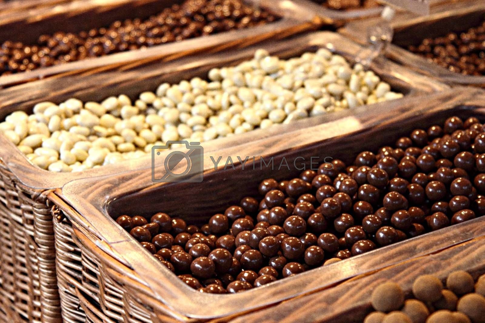 Royalty free image of Special chocolate balls in baskets in different flavours by balage941