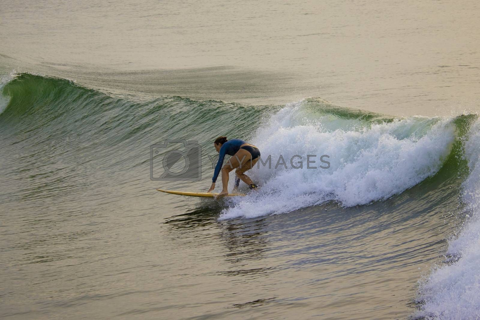 Chennai, Tamilnadu -India . September 2, 2020. A foreign lady tourists surfing the sea waves
