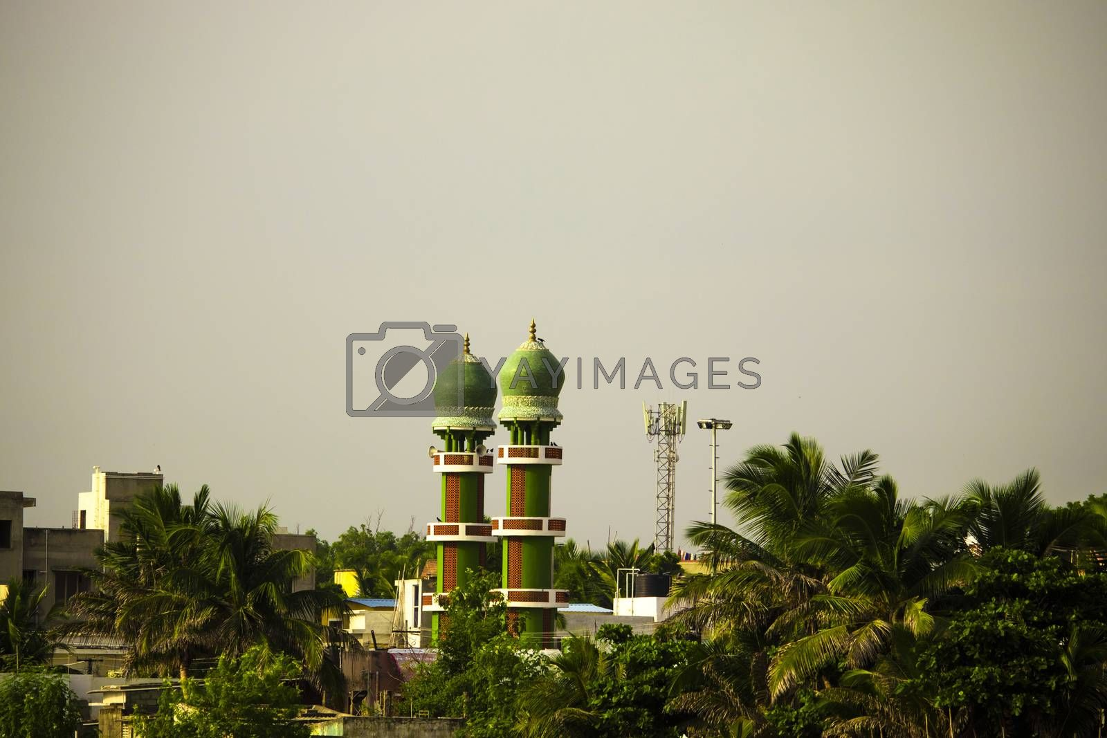 The upper two green towers of the Muslim's Holy Mosque in Chennai
