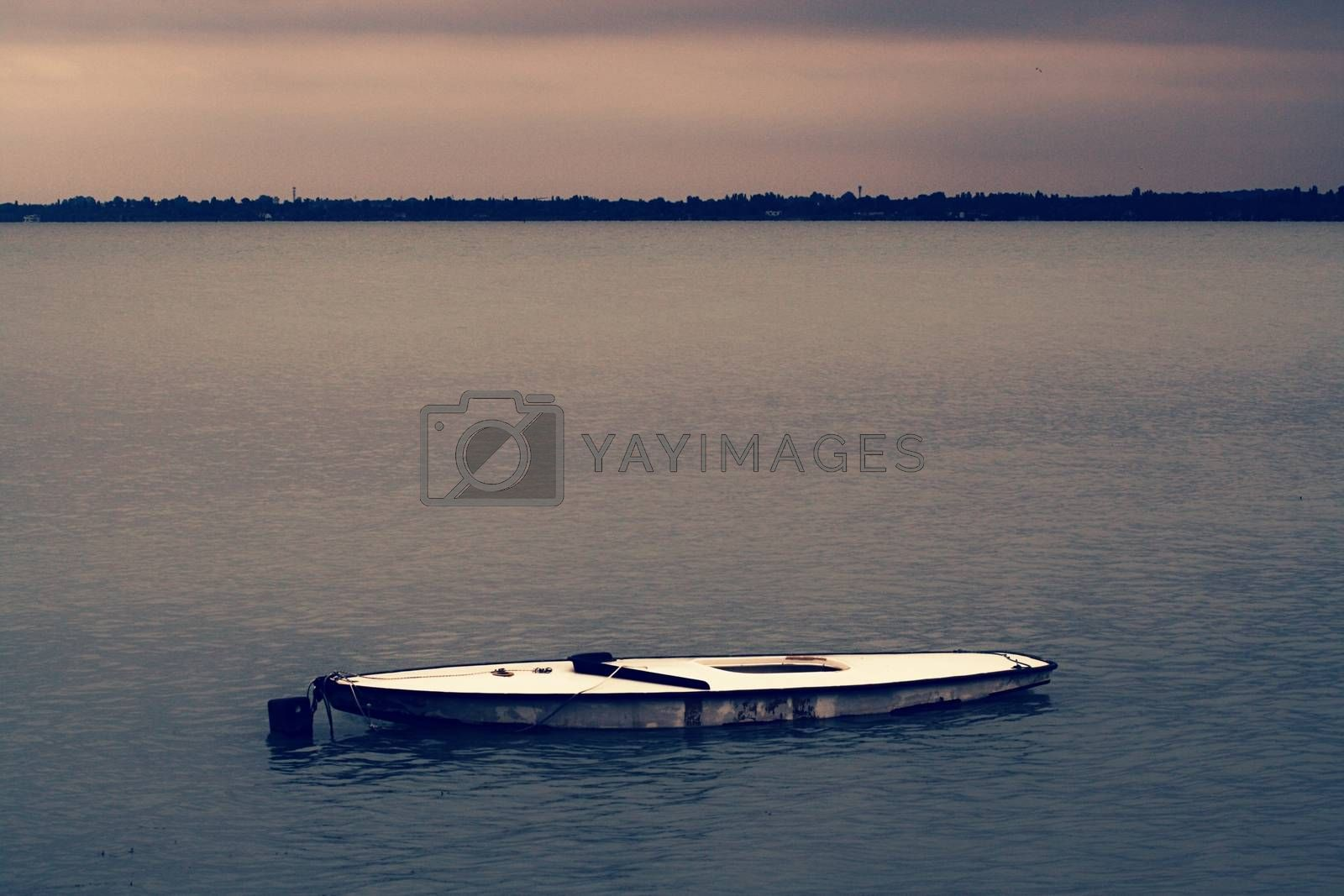 Royalty free image of A small boat in a large body of water by balage941