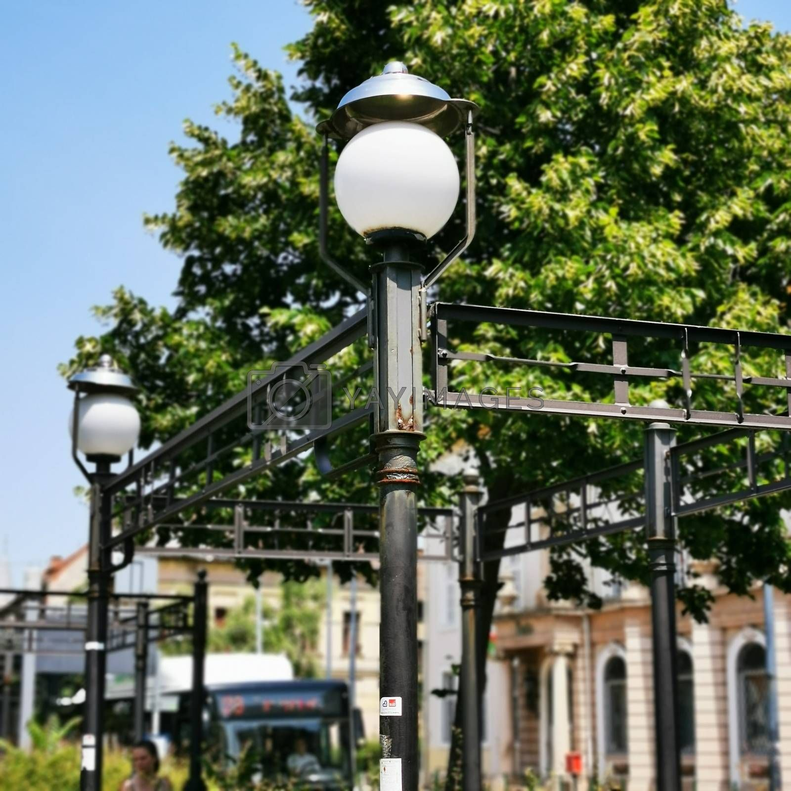 Royalty free image of Cozy series of lamps in downtown Miskolc by balage941