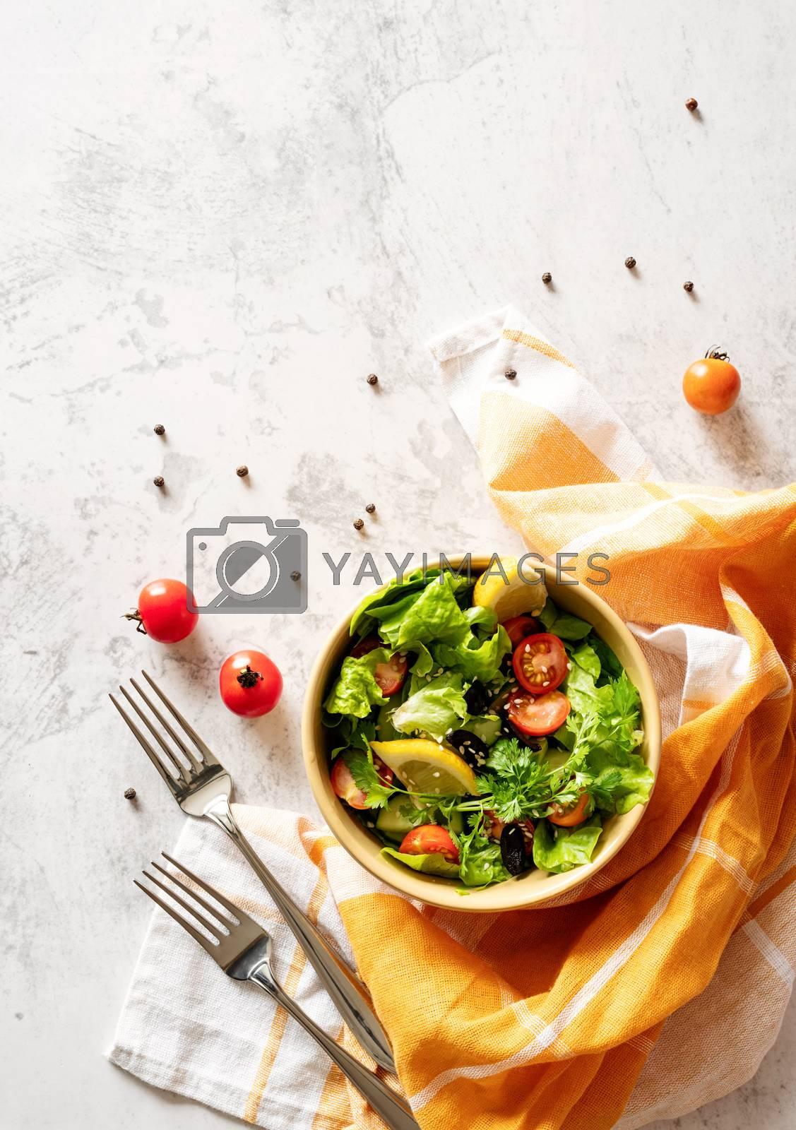 Royalty free image of bowl of vegetable mixed salad top view flat lay by Desperada